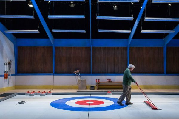 Guy Bannerman. (Set and lights by Steve Lucas.) Photo: Randy deKleine-Stimpson. The New Canadian Curling Club - Thousand Islands Playhouse 2019